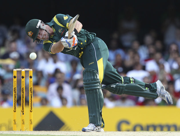 Australia's Dan Christian smashes a four during the One Day International cricket match between Australia and India in Brisbane, Australia, Sunday, Feb. 19, 2012. (AP Photo/Tertius Pickard)