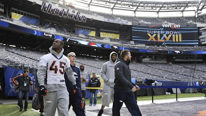 Denver Broncos cornerback Dominique Rodgers-Cromartie (45) looks around MetLife Stadium as he arrives for the team's walk-through on Saturday, Feb. 1, 2014, in East Rutherford, N.J. The Broncos are scheduled to play the Seattle Seahawks in the NFL Super Bowl XLVIII football game Sunday