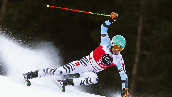 Neureuther of Germany clears a gate during the men's World Cup Giant Slalom skiing race in Alta Badia