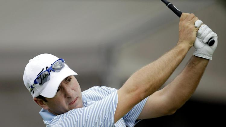 Ben Curtis watches his drive on the 17th tee during the second round of the Texas Open golf tournament on Friday, April 20, 2012, in San Antonio. Curtis is 10-under par after two rounds. (AP Photo/Eric Gay)
