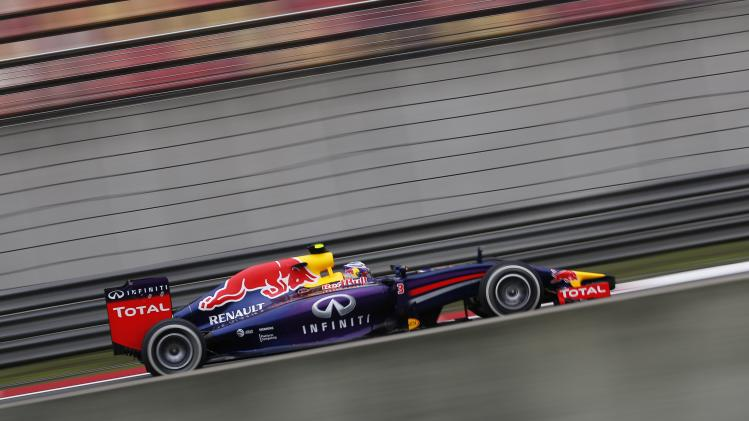 Red Bull Racing Formula One driver Ricciardo of Australia drives during the first practice session of the Chinese F1 Grand Prix at the Shanghai International circuit