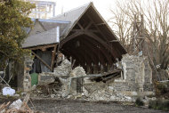 Damaged St. John the Baptist Church is seen following series of earthquakes that shook Christchurch, New Zealand, Monday, June 13, 2011. A series of aftershocks rattled New Zealand's quake-devastated city of Christchurch again Monday, toppling one of the few buildings still standing downtown and sinking thousands of homes into darkness. (AP Photo/New Zealand Herald, Geoff Slone) NEW ZEALAND OUT, AUSTRALIA OUT