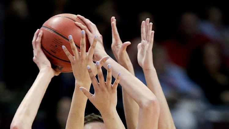 championship college basketball game, Tuesday, March 11, 2014, in Las