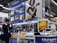 An Olympus display at a Tokyo camera shop. Electronics giant Sony will invest 50 billion yen ($645 million) in scandal-tainted Olympus, the firms have said, as they both look to turn the page on disastrous chapters