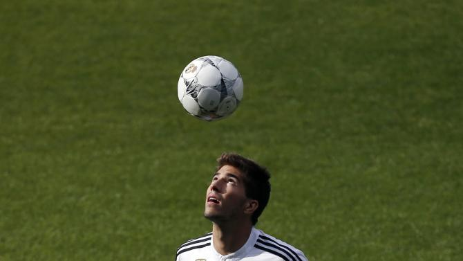 Real Madrid's new player Silva controls a ball during his presentation ceremony at Santiago Bernabeu stadium in Madrid