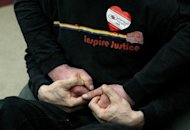 "A same-sex couple hold hands at a press conference at San Francisco City Hall in February. ""Congratulations, Mr. President, for making history today by becoming the first sitting president to explicitly support marriage for same-sex couples,"" said Rea Carey, executive director of the National Gay and Lesbian Task Force"