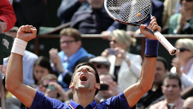 Serbia's Novak Djokovic reacts after defeating Germany's Philipp Kohlschreiber during their fourth round match of the French Open tennis tournament at the Roland Garros stadium Monday, June 3, 2013 in Paris. (AP Photo/Michel Euler)