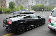 This photo taken on April 18, 2013 shows a Lamborghini being driven on a street in Shanghai. China became the world's largest auto market in 2009. Last year, its auto sales reached 19.31 million vehicles, a 4.3 percent rise from 2011, according to a Chinese industry group
