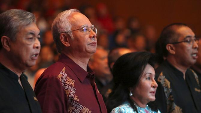 Malaysia's Prime Minister Najib Razak and wife Rosmah Mansor arrives before Najib's National Day speech in the capital city of Kuala Lumpur
