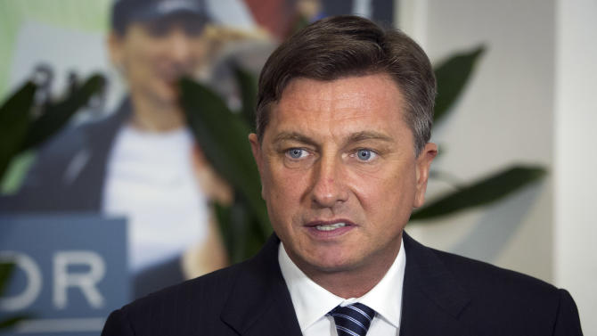 Slovenia's former prime minister Borut Pahor talks to the media at his headquarters in Ljubljkana, Slovenia, Sunday, Dec. 2, 2012. An exit poll published by Slovenia's state television has shown that former prime minister Borut Pahor has won the presidential election in the crisis-hit EU country with 67.3 percent of the vote.  (AP Photo/Darko Bandic)