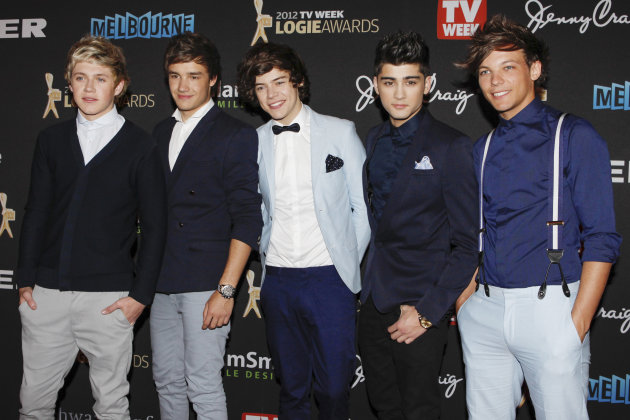 "FILE - This is a Sunday, April 15, 2012 file photo of British boy-band One Direction arrive for the Logies, an Australian television industry awards night, in Melbourne, Australia. One Direction's latest single sums it up. ""Live While We're Young"" is the first track off their second album, and the boys are happy to have it as a motto. The members of the British pop group admit they're making the most of being young, successful and extremely popular. (AP Photo/Paul Jeffers, File)"
