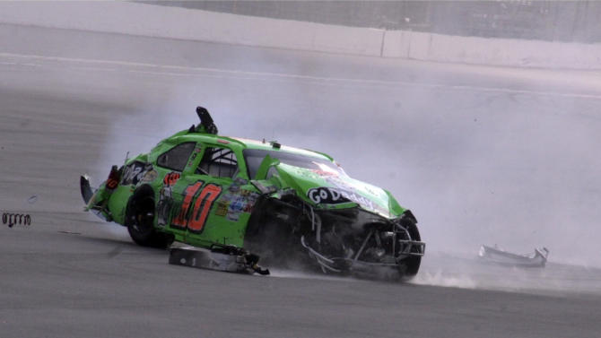 Danica Patrick's car slides down the track after a crash during the first of two NASCAR Daytona Duel 150 qualifying auto races in Daytona Beach, Fla., Thursday, Feb. 23, 2012. (AP Photo/Chuck McQuinn)