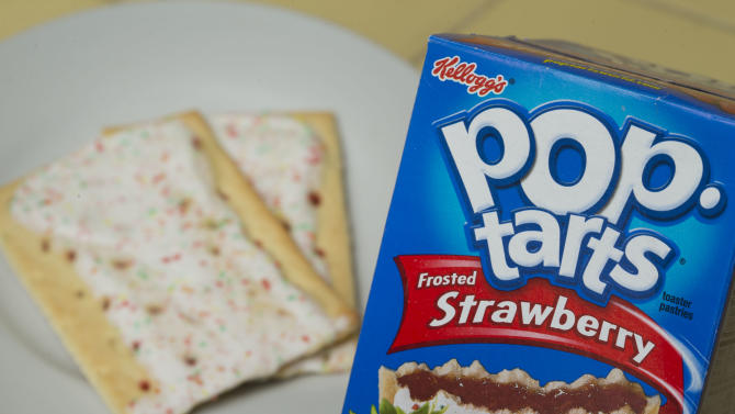 In this Monday, April  29, 2013 photo, Kellogg's brand Strawberry flavored Pop-Tarts are arranged for a photo in Surfside, Fla. Kellogg Co. reports quarterly financial results before the market opens on Thursday, May 2, 2013. (AP Photo/Wilfredo Lee)