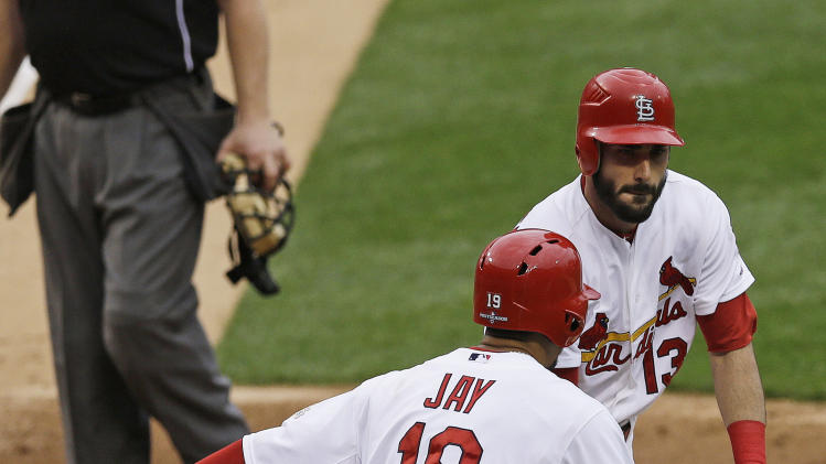 St. Louis Cardinals' Matt Carpenter (13) celebrates his two-run home run with  Jon Jay (19) during the third inning of Game 3 of baseball's National League championship series against the San Francisco Giants, Wednesday, Oct. 17, 2012, in St. Louis. (AP Photo/Patrick Semansky)