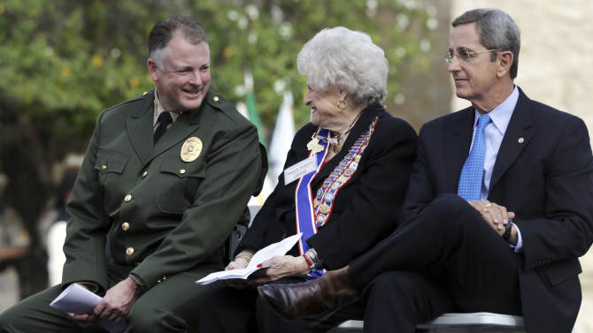 "Will Travis, left, Denton County Sheriff, and fifth great nephew of William Barret Travis, chat with Karen Thompson President General of the Daughters of the Republic of Texas, center, with Jerry Patterson, right, Texas Land Commissioner. Brought by police escort and welcomed with honor guards, drawn swords and a drum roll, the iconic ""Victory or Death"" letter written by Alamo commander William Barret Travis returned Friday to San Antonio for the first time since it left by courier at the start of the famous siege at the old Spanish mission 177 years ago.(AP Photo/San Antonio Express-News, Bob Owen) RUMBO DE SAN ANTONIO OUT; MAGS OUT; NO SALES; MANDATORY CREDIT"