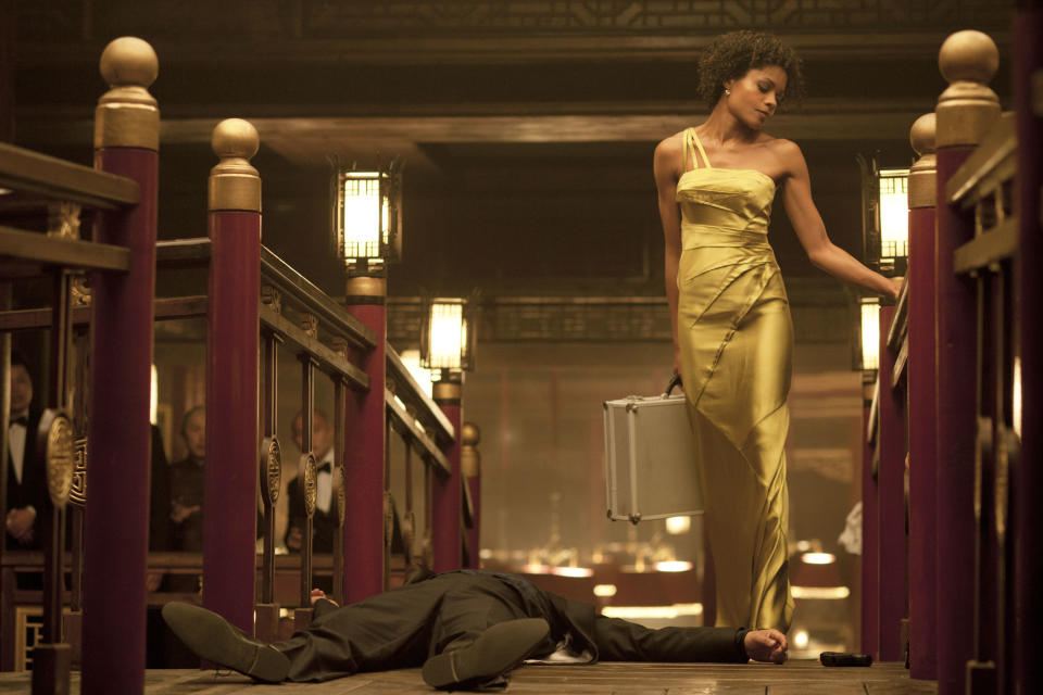 "This film image released by Sony Pictures shows Naomie Harris in a scene from the film ""Skyfall."" Costume designer Jany Temime says her mantra for the entire wardrobe of ""Skyfall,"" which opens Friday, was ""iconic for 2012.""   (AP Photo/Sony Pictures, Francois Duhamel)"