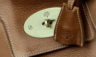 Mulberry Profits Dive Amid 'Top End' Focus