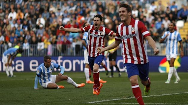Atletico Madrid's David Villa (C) celebrates a goal scored by his team mate Koke (R) against Malaga (Reuters)