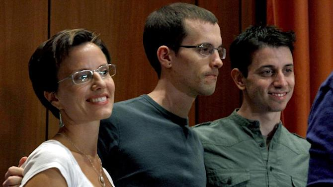 From left, Sarah Shourd, Shane Bauer, and Josh Fattal, stand together after a news conference on Sunday, Sept. 25, 2011 in New York.    Fattal and Bauer, both 29, were freed last week under a $1 million bail deal and arrived Wednesday in Oman, greeted by relatives and fellow hiker Shourd, who was released last year.   The two American hikers held for more than two years in an Iranian prison.   (AP Photo/Craig Ruttle)