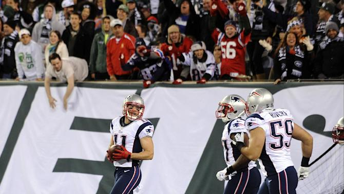 New England Patriots wide receiver Julian Edelman (11) celebrates with teammates after returning a fumble for a touchdown during the first half of an NFL football game against the New York Jets, Thursday, Nov. 22, 2012, in East Rutherford, N.J. (AP Photo/Bill Kostroun)