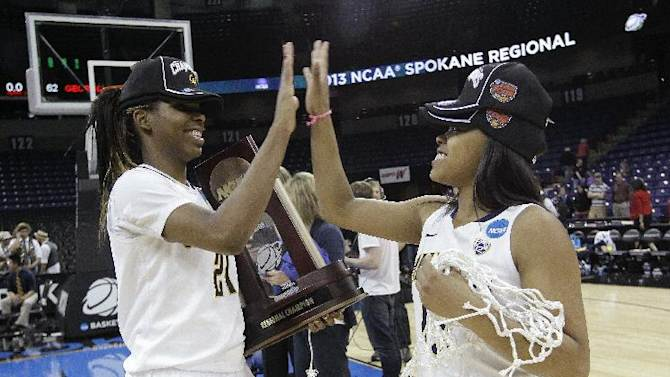California's Reshanda Gray, left, celebrates with Brittany Boyd after their team beat Georgia in overtime in a regional final in the NCAA women's college basketball tournament, Monday, April 1, 2013, in Spokane, Wash. Cal won 65-62. (AP Photo/Elaine Thompson)