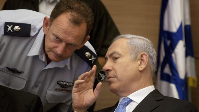 Israeli Prime Minister Benjamin Netanyahu, right, listens to his military advisor Maj. Gen. Yohanan Locker, as he attends a meeting of the Foreign Affairs and Defense Committee, in the Knesset, Israel's parliament in Jerusalem, Monday, Aug. 1, 2011. (AP Photo/Sebastian Scheiner)