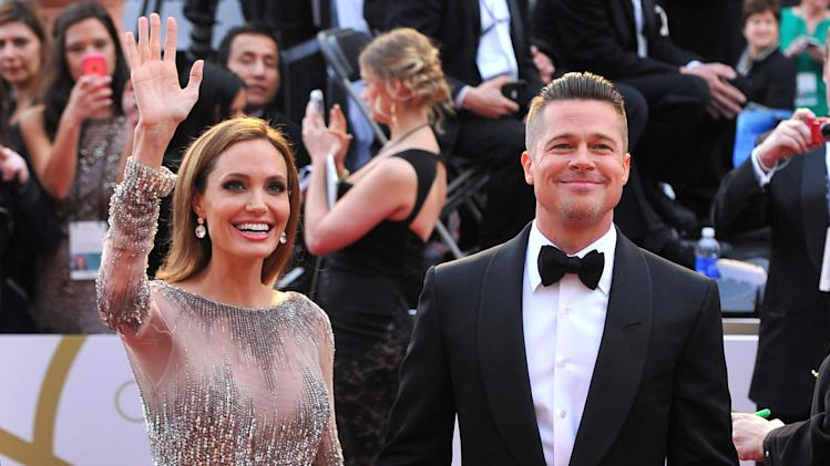 FILE - In this Sunday, March 2, 2014, file photo, Angelina Jolie, left, and Brad Pitt arrive at the Oscars at the Dolby Theatre in Los Angeles. Jolie and Pitt were married Saturday, Aug. 23, 2014, in France, according to a spokesman for the couple. (Photo by Vince Bucci/Invision/AP, File)