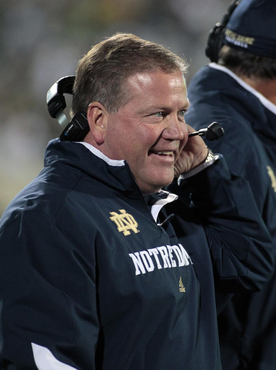 Notre Dame coach Brian Kelly stands on the sideline during the first quarter of an NCAA college football game against Michigan State, Saturday, Sept. 15, 2012, in East Lansing, Mich. (AP Photo/Al Goldis)
