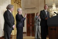 U.S. President Barack Obama winks at his nominees for several cabinet positions in his government, in the East Room of the White House in Washington, March 4, 2013. REUTERS/Jason Reed
