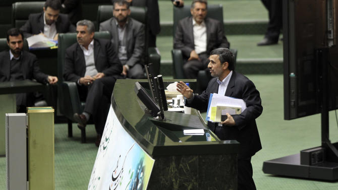 Iranian President Mahmoud Ahmadinejad, concludes his speech in the parliament during impeachment proceedings of his labor minister, Abdolreza Sheikholeslami, unseen, in Tehran, Iran, Sunday, Feb. 3, 2013. Iranian lawmakers impeached the country's labor minister over his controversial appointment of an official implicated in the deaths of prisoners. (AP Photo/Vahid Salemi)