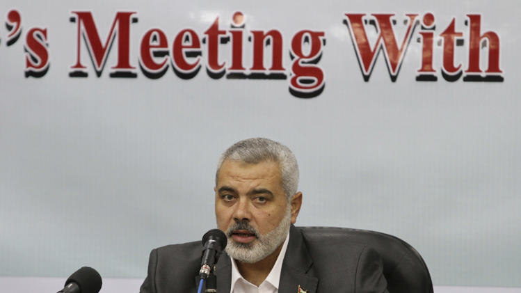 Gaza's Hamas Prime Minister Ismail Haniyeh speaks at his office in Gaza City , Wednesday, Dec. 1, 2010. Haniyeh on Wednesday denied Israeli allegations that al-Qaida operates in the territory and that Gaza militants planned to carry out attacks in neighboring Egypt. (AP Photo/Hatem Moussa)