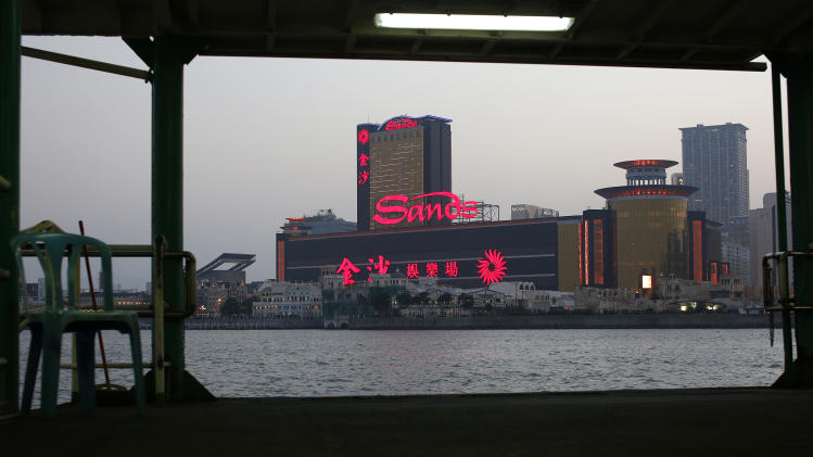 In this Oct. 25, 2012 photo, Sands Casino complex is lit up in Macau. Hordes of Chinese high rollers flooding into Macau have turned the city into an Asian casino boomtown but they're also posing a challenge for China's next generation of leaders. (AP Photo/Vincent Yu)