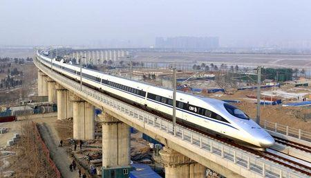 A high-speed train travelling to Guangzhou is seen running on Yongdinghe Bridge in Beijing