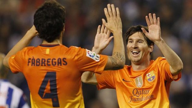 Barcelona's Lionel Messi (R) celebrates his goal against Deportivo Coruna with his team-mate Francesc Fabregas (Reuters)