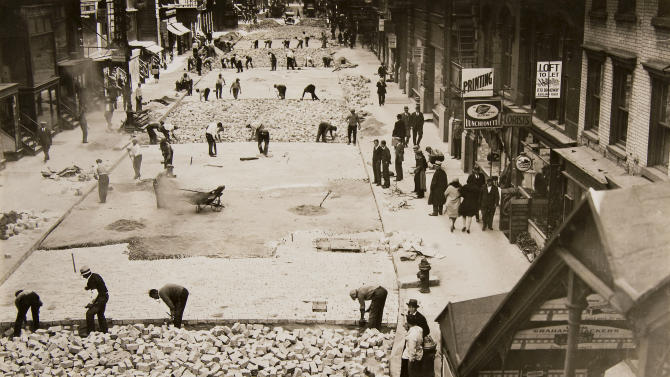 In this Oct. 2, 1930 photo provided by the New York City Municipal Archives, workers assemble bricks to build the roadway on 28th Street in New York. Over 870,000 photos from an archive that exceeds 2.2 million images have been scanned and made available online, for the first time giving a global audience a view of this rich collection that documents life in New York City.  (AP Photo/New York City Municipal Archives, Borough President Manhattan) MANDATORY CREDIT