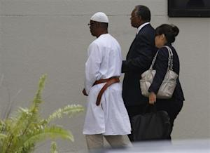 Potts is escorted into Miami FBI headquarters after he was taken into custody after arriving in the U.S. in North Miami Beach