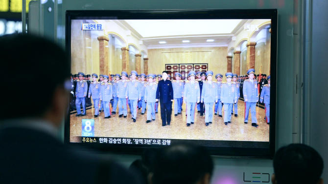 People watch TV news program showing North Korean leader Kim Jong Un, center, at Seoul Railway Station in Seoul, South Korea, Monday, April 15, 2013. Oblivious to international tensions over a possible North Korean missile launch, Pyongyang residents spilled into the streets Monday to celebrate a major national holiday, the birthday of their first leader, Kim Il Sung. (AP Photo/Ahn Young-joon)
