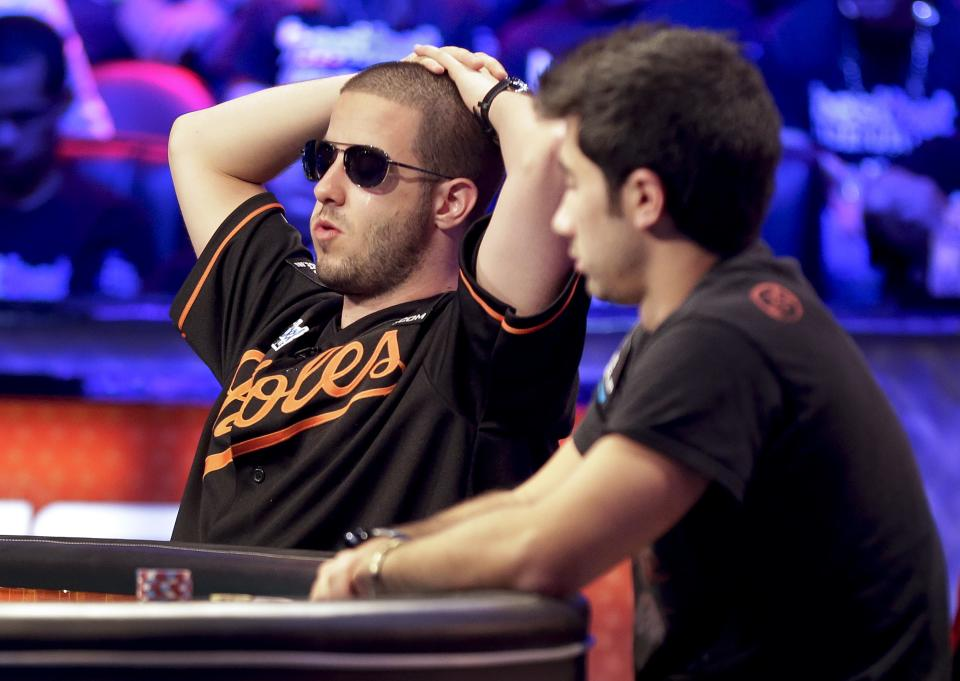 Greg Merson, left, and Jesse Sylvia watch play during the World Series of Poker Final Table event, Tuesday, Oct. 30, 2012, in Las Vegas. (AP Photo/Julie Jacobson)