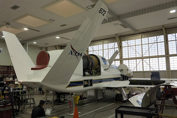 NASA Global Hawk being loaded with monitoring equipment for the ATTREX mission.