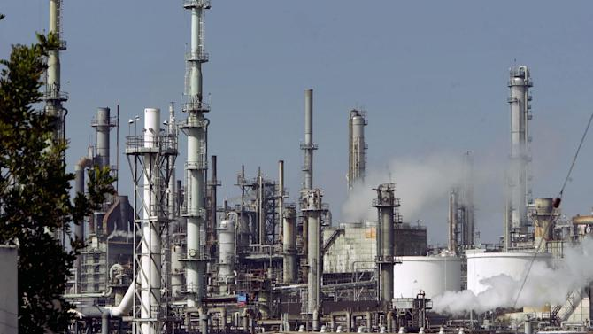 FILE - This July 6, 2006 file photo shows the ConocoPhillips Los Angeles Refinery in operation. The Environmental Protection Agency is coming to one of the nation's largest petroleum producing areas to hold public hearings, Wednesday, July 16, 2014 on a proposal officials say would reduce toxic air pollution from California to Texas through tough new controls on oil refineries. (AP Photo/Ric Francis,File)
