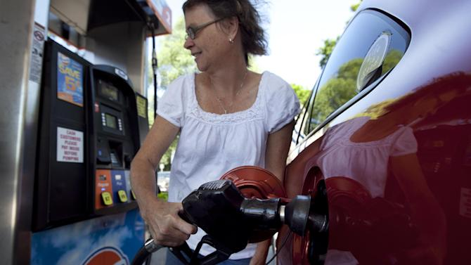 FILE - In this July 10, 2012 file photo, Suzanne Meredith, of Walpole, Mass., gases up her car at a Gulf station in Brookline, Mass. Gasoline is at $3.50 per gallon for the first time this summer after a sharp run-up in July. The price of gas rose 17 cents per gallon, or 5.1 percent this month, as oil rose and drivers burned more fuel on summer road trips. It was the first monthly increase since March, and the biggest gain in any July since auto club AAA started keeping records in 2000. (AP Photo/Steven Senne, File)