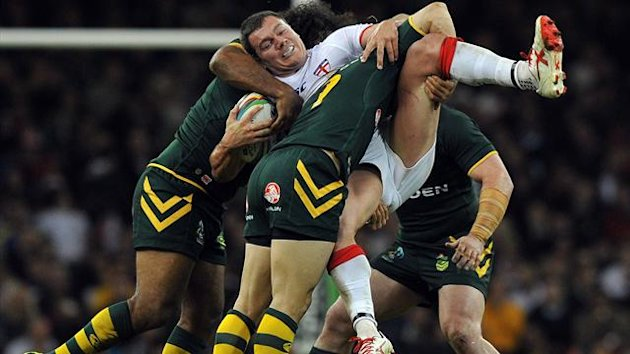 England's Brett Ferres is tackled during the 2013 Rugby League World Cup group A match between Australia and England at the Millennium Stadium in Cardiff (AFP)
