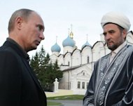 Russian leader Vladimir Putin (left) speaks with Mufti Ildus Faizov during a 2011 visit to Kazan, the capital of Tatarstan. The Islamic leader of Tatarstan -- Russia's largest Muslim region -- was wounded and his deputy was killed in two separate attacks, investigators said