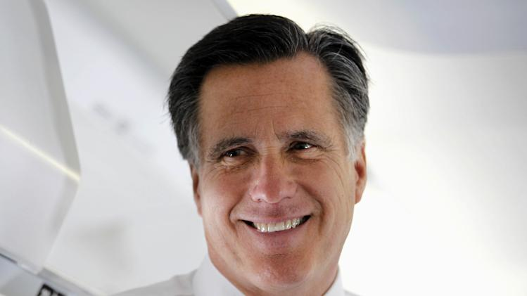 Republican presidential candidate, former Massachusetts Gov. Mitt Romney talks to reporters on his campaign plane before taking off for Boston, Tuesday, March 6, 2012, in Columbus, Ohio. (AP Photo/Gerald Herbert)