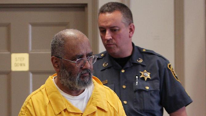 Jose Feliciano, 66, is walked into Morris County Superior Court before he was sentenced Friday April 20, 2012 in Morristown, N.J. Feliciano , a former church janitor was sentenced Friday to life in prison without parole for the 2009 stabbing death of a beloved New Jersey priest who had fired him. (AP Photo/The Daily Record, Bob Karp, Pool)