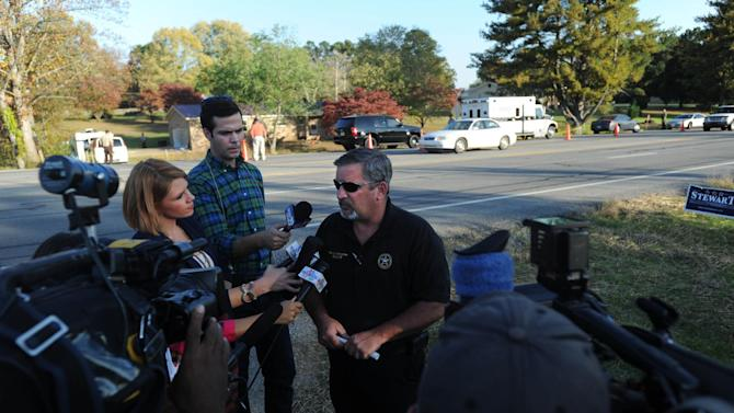 Lincoln County Sheriff Murray Blackwelder talks to the press, Monday, Oct. 22, 2012. The slayings of three women and a toddler at two homes in southern Tennessee may be related to a body found just across the state line in Alabama, authorities said Tuesday. On Monday, Tennessee officials found three women and an 18-month-old boy dead at two different homes in Lincoln County, about 100 miles south of Nashville. (AP Photo/The Huntsville Times, Sarah Cole)