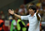Germany coach Joachim Loew, pictured in June 2012, was on Monday given the backing of the country's football federation, nearly six weeks after his side was knocked out of the Euro 2012 semi-finals