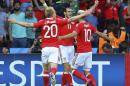 From left, Wales's Jonathan Williams, Wales's Gareth Bale and Wales's Aaron Ramsey celebrate after Northern Ireland's Gareth Mcauley, not in pic, scored a self goal, during the Euro 2016 round of 16 soccer match between Wales and Northern Ireland, at the Parc des Princes stadium in Paris, Saturday, June 25, 2016. (AP Photo/Thibault Camus)
