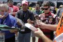 Jeff Gordon signs autographs before practice for Sunday's NASCAR Coca-Cola 600 Sprint Cup series auto race at Charlotte Motor Speedway in Concord, N.C., Thursday, May 21, 2015. (AP Photo/Chuck Burton)