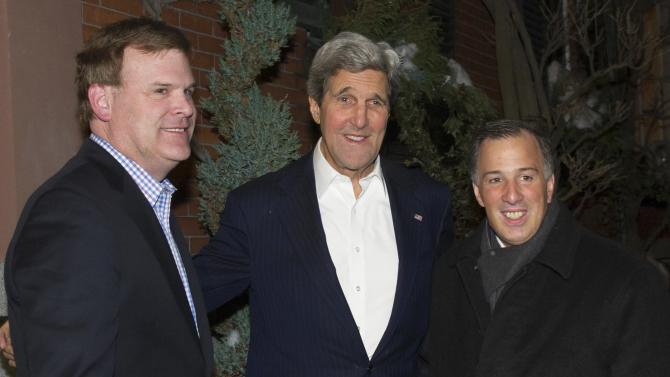 Kerry greets Baird and Meade at his home in Boston